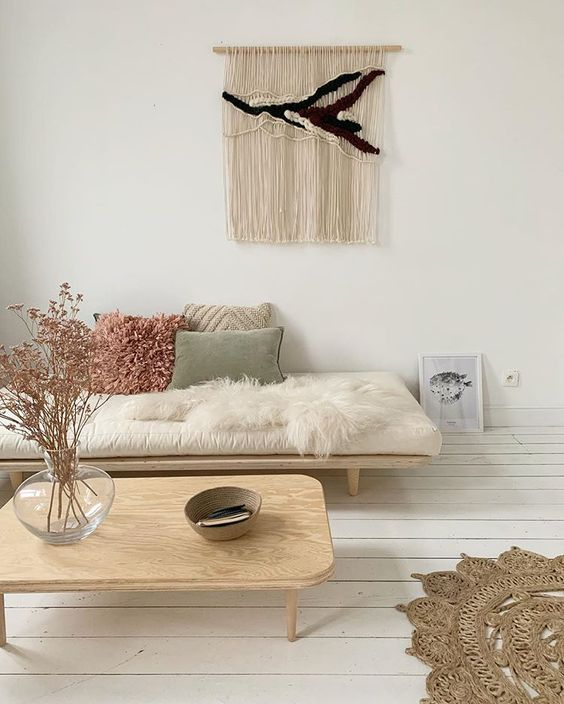 living room, white wooden floor, white wall, wooden bench white cushion, wooden coffee table, rug