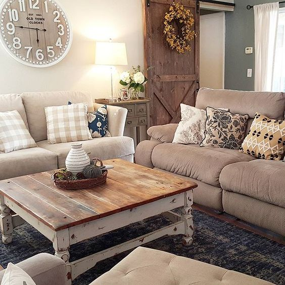 living room, wooden floor, grey rug, brown sofa, wooden square coffee table, white wall, wooden sliding door