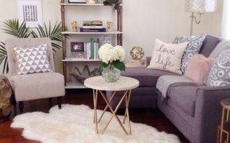 living room, wooden floor, purple corner sofa, white coffee table, shelves, pink chair, side table