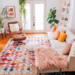 Living Room, Wooden Floor, White Wall, Cream Corner Sofa, Brown Leather Lounge Chair, White Shelves