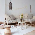 Living Room, Wooden Floor, White Wall, Wooden Sofa, Striped Cushion, White Rattan Coffee Table, Black Rattan Pendant