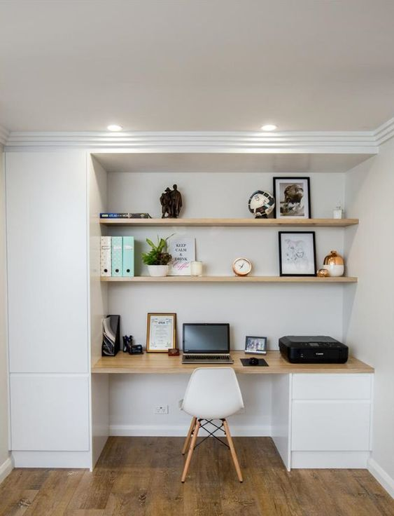 minimalist study on the nook, white wall, white cabinet, wooden open shelves, wooden top table, white modern chair