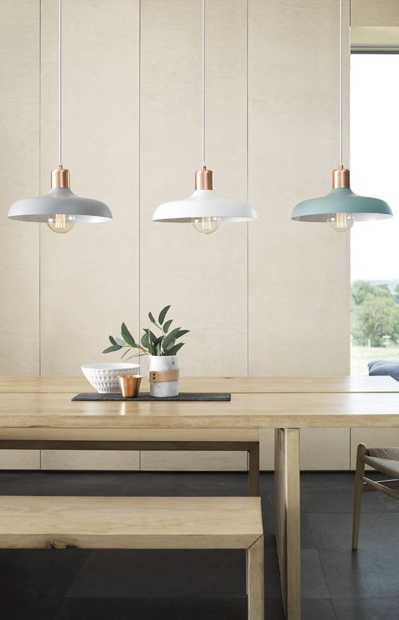 modern pendant with blue and white, wooden table, white wall
