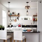 Open Kitchen, Wooden Floor, White Wall, White Island, White Bar Stool, Black Top Island, Black Top Cabinet, Open Shelves, Industrial Lamps