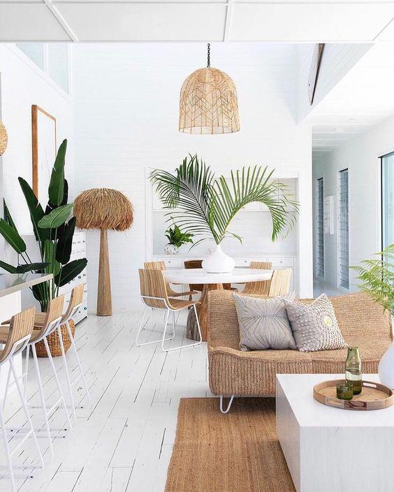 open living room, white wooden floor, rattan rug, rattan sofa, white wall, rattan pendant