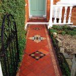 Pathway, Orange Floor Tiles, Orange Open Wall, Green Door, White Window, White Fence