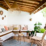 Patio, Wooden Floor, Built In White Corner Benh, White Wall, Pillows, Wooden Ceiling, Beams, Rattan Chair, Blue Rug
