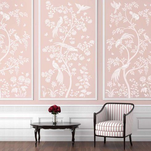 pink wall, pink wallpaper, white wainscoting, round dark wooden table, striped chair