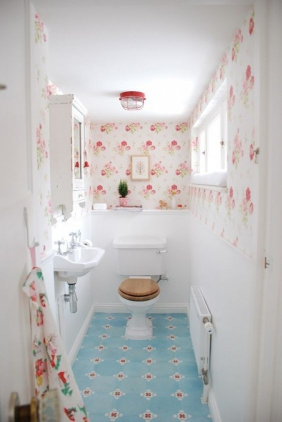 powder room, white wall, patterned wallpaper, blue patterned lfoor tiles
