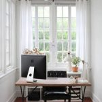 Small Study Nook, White Wall, Wooden Floor, Wooden Table, Black Leather Chair, Brown Rug, Pendant