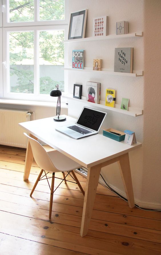 small study, white wooden table, white wooden chair, open shelves, window