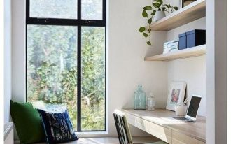 study, grey floor, floating wooden table with drawer, floating open shelves, wooden window bench, pillows, white pendant