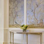 Tall Flowery Painting, White Wall, Golden Console Table, Wooden Floor