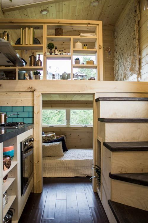 tiny house, dark wooden floor, wooden wall, wooden shelves fence, wooden shelves on the kitchen