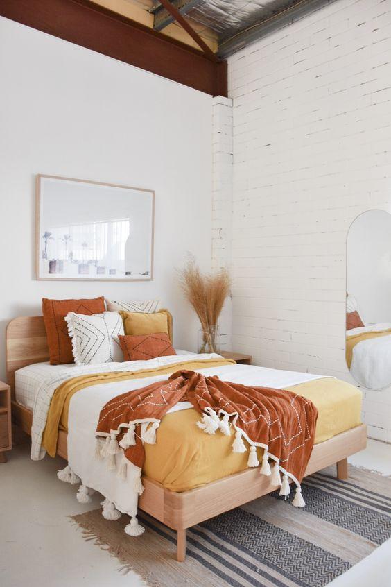 white bedroom, white floor, white open wall, white wall, mirror, wooden bed platform