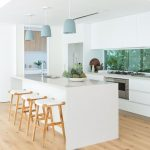 White Kitchen, White Wall, White Island, Wooden Shite Stool, Pale Blue Pendant, Silver Top