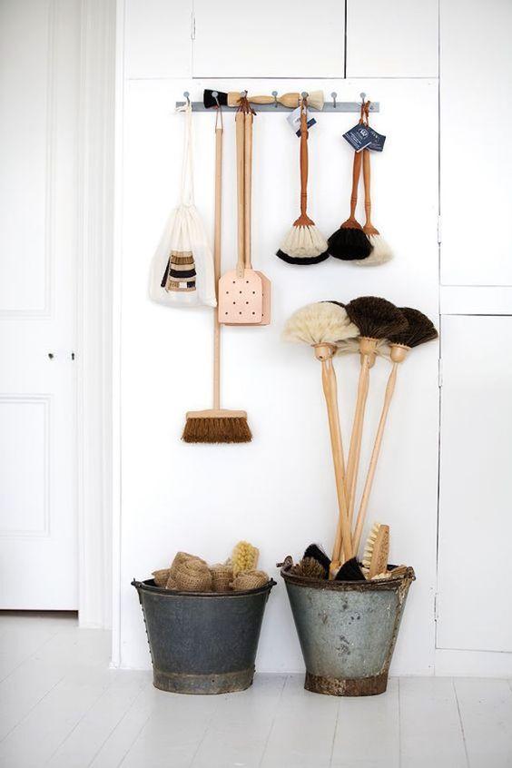white wall, hooks, bucket,