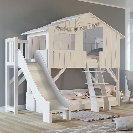 white wooden bunk bed, house shaped at top, vertical stairs, slide at the side