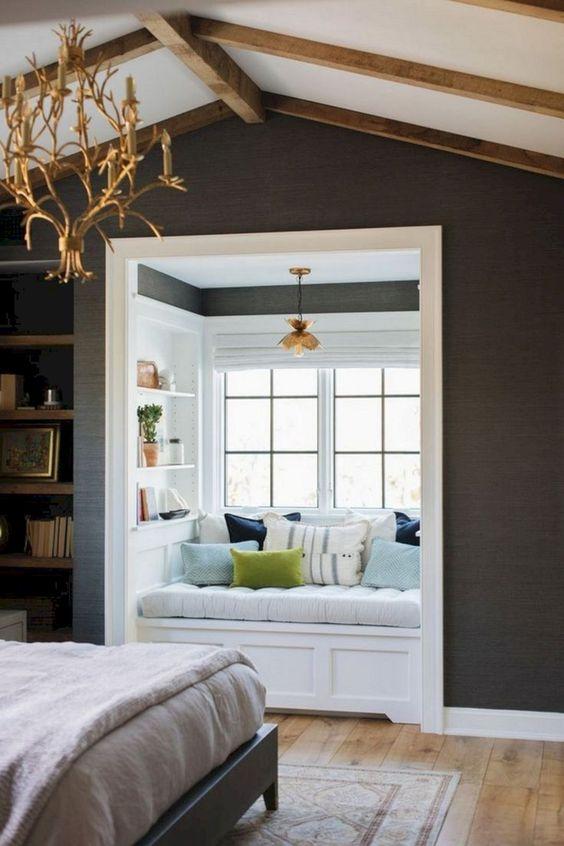 window nook, wooden floor, grey wall, white shelves inside, golden pendant