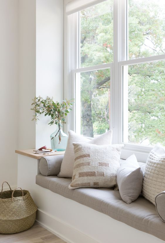 window seat, white built in bench, grey cushion, pillows