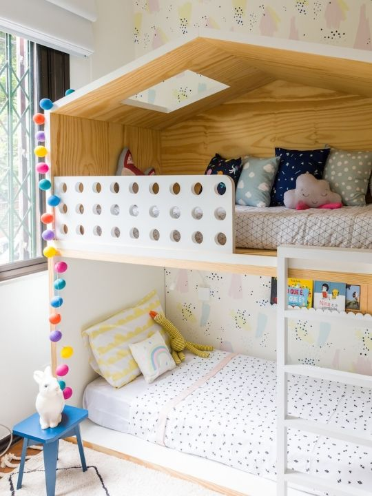 wooden bunk bed, house roof ontop, white fence with hole at top, whtie vertical stairs