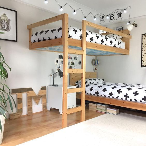wooden bunk bed, not connected, vetical stairs, white linen, white wall, white and wooden floor, white side table