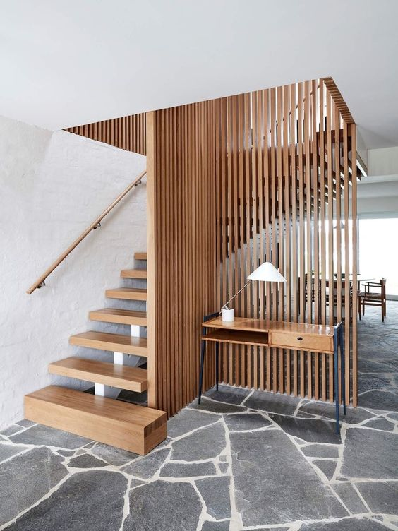 wooden grid partition on the stairs, wooden stairs, grey stone floor tiles