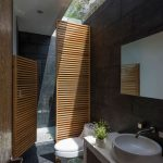 Wooden Grid Shower Partition, Grey Floor, Grey Wall, White Vanity, White Round Sink, Mirror