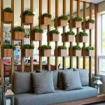 Wooden Square Pots Between Wooden Bars, Wooden Bench With Grey Cushion
