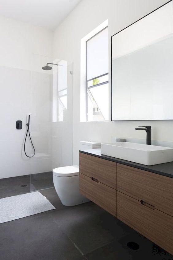 bathroom, black floo, white seamless wall, wooden floating vanity, black top, white sink, large square mirror, large glass window, white toilet
