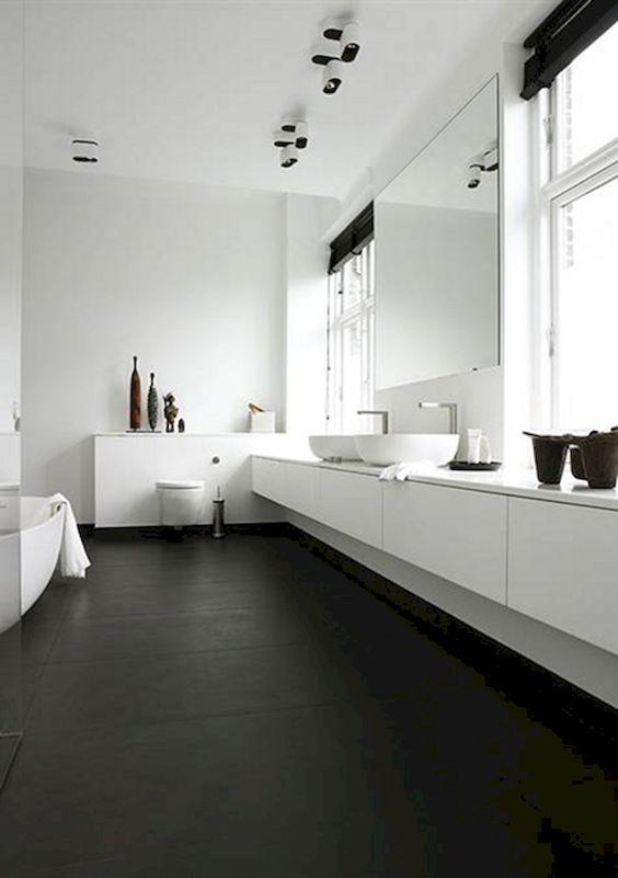 bathroom, black floor, white floaing vanity, white top, white wall, white tub, white toilet, large mirror, glass window