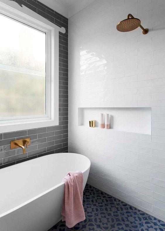 bathroom, black patterned floor tiles, white subway wall tiles, black subway wall tiles, large glass window, gold shower, white tub