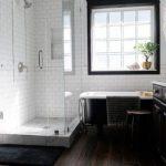 Bathroom, Black Wood Floor Tiles, White Subway Wall, Black Tub, Shower Area, Dark Cabinet, White Top