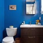 Bathroom, Blue Wall, Wooden Vanity Cabinet White Counter Top, White Toilet, Brown Floor Tiles