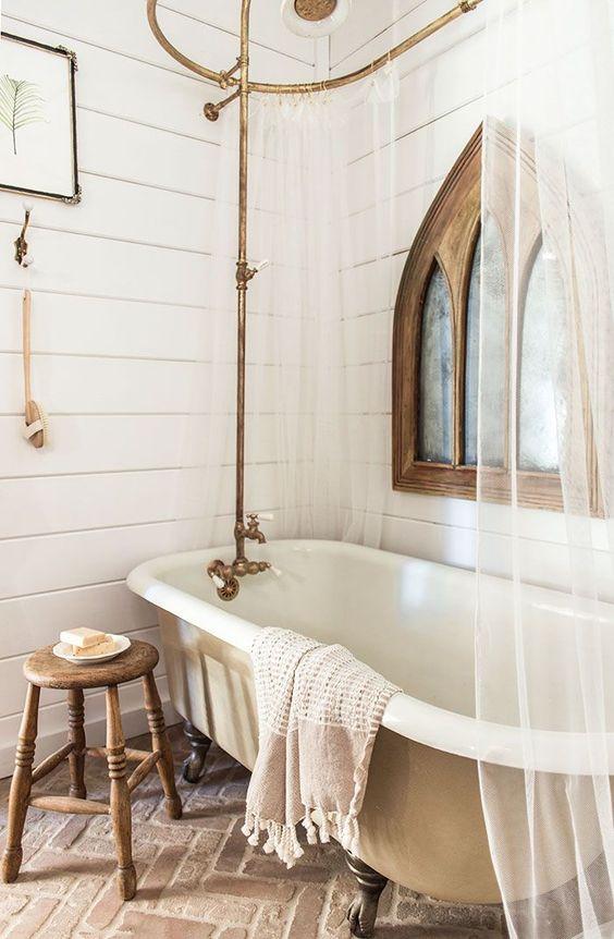 bathroom, brick herringbone floor tiles, white wooden wall plank, golden rod, golden ring,white tub curtain
