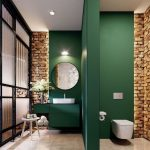 Bathroom, Green Wall, Exposed Brich Look, Brown Marble Floor Tiles, White Toilet, Green Vanity, White Sink, Round Mirror