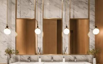 bathroom, marble wall, marble floor, marble sink, golden vanity, golden framed mirror, golden pendants, golden accent wall