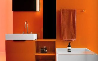 bathroom, orange wall, white tub, orange floating vanity with shelves, white tub,