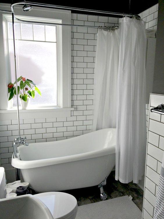 bathroom, patterned floor, white subway wall tiles, white tub curtain, white tub, white framed window, white toilet