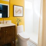 Bathroom, Patterned White Black Floor, Wooden Cabinet Counter, White Top, Yellow Wall, White Shower Area, White Toilet