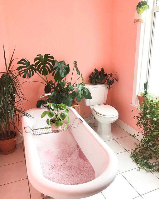 bathroom, pink wall, white tub, white floor tiles, white toilet