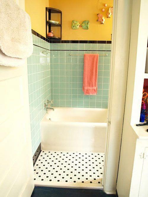 bathroom, tiny black and white floor tiles, green wall tiles, white tub, yellow wall