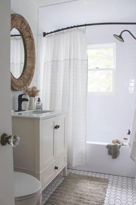bathroom, white floor tiles, white wall tiles, white cabinet vanity, white counter top, white toilet, round rattan framed mirror