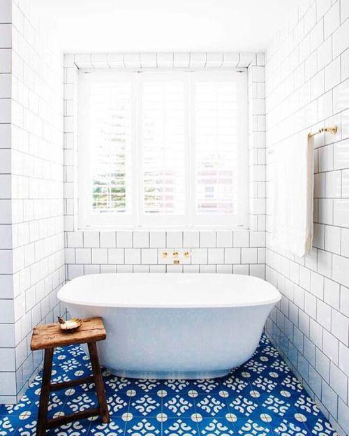 bathroom, white subway tiles, blue pattern floor tiles, windows, white tub