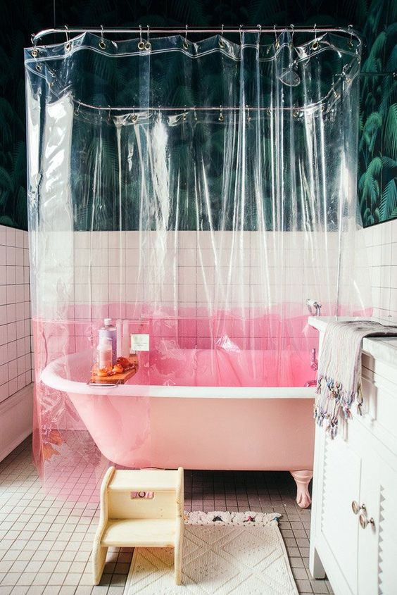 bathroom, white wall tiles, white floor tiles, green leaves wallpaper, clear curtain with pink color