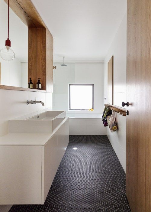 bathroom, white wall, white tub, white floating vanity and cabinet, wooden framed mirror, white sink