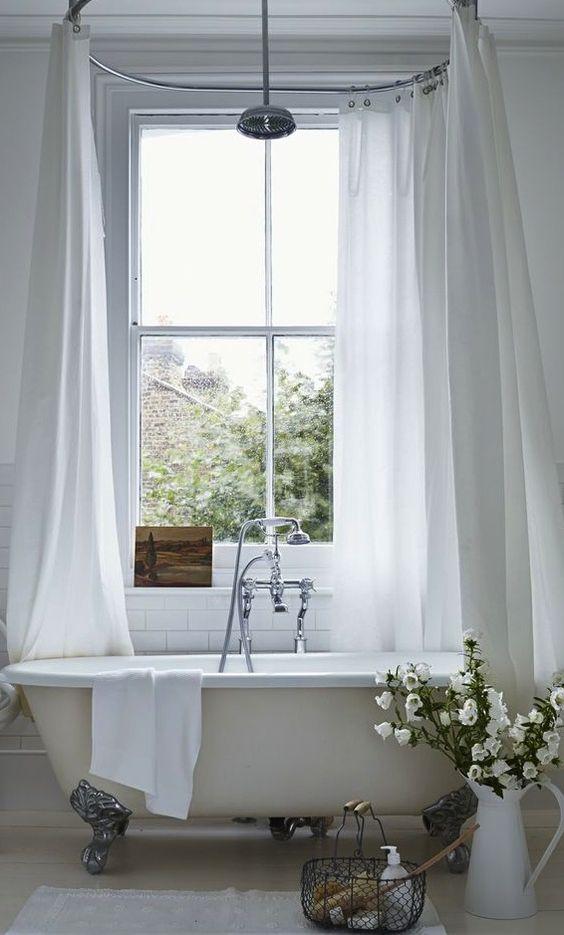 bathroom, white wooden floor, white wall, white tall tub curtain, white tub