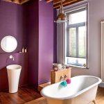 Bathroom, Wooden Floor, Purple Wall, Wooden Beamson The Ceiling, White Sink, White Tub