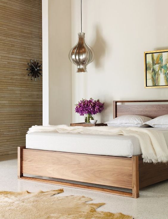 bedroom, white floor, white wall, wooden bed platform, silver onion pendant, wooden side table, white wall