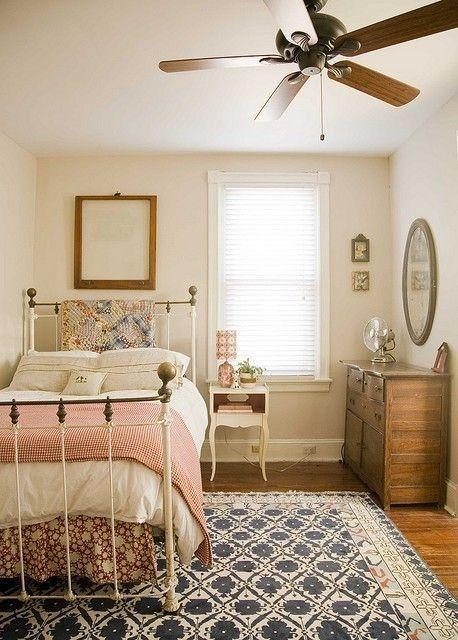 bedroom, wooden floor, white wall, rug, white metal bed platform, wooden cabinet, white wooden sidetable
